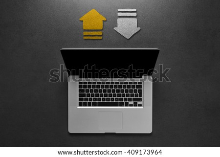Top view laptop isolated on black desktop with copyspace. Cloud and sharing connections for laptop. Sharing online data through internet with network and wireless connection. - stock photo