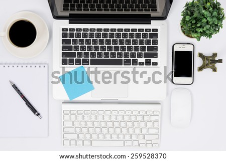 Top view laptop or notebook workspace office on white table - stock photo