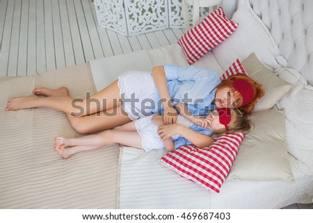 TOP VIEW: Little daughter sleeps with her mother