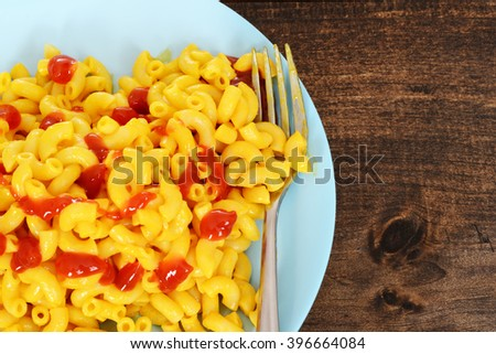 top view macaroni and cheese with fork - stock photo