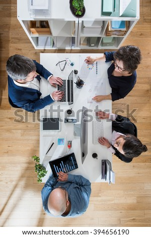 Top view, Meeting for the business team, brainstorming for the new project. Focus on the table - stock photo
