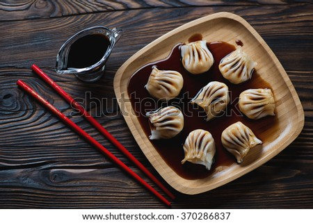 Top view of a bamboo tray with dim-sum dumplings, studio shot
