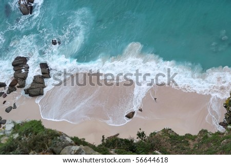 Top view of a beach with sand and waves - stock photo
