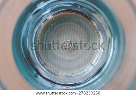 top view of a blue glass of water - stock photo