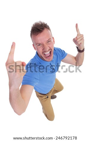 top view of a casual young man cheering with his fingers raised . on a white background - stock photo