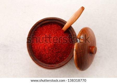 top view of a chilli powder in wooden container - stock photo