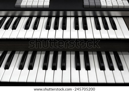 Top view of a church organ keyboard. The organ is a musical instrument used in churches or cathedrals. - stock photo