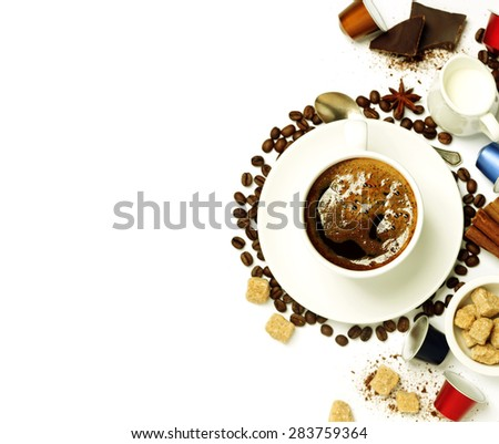 Top view of a cup of coffee with coffee beans, sugar, milk and capsules - stock photo