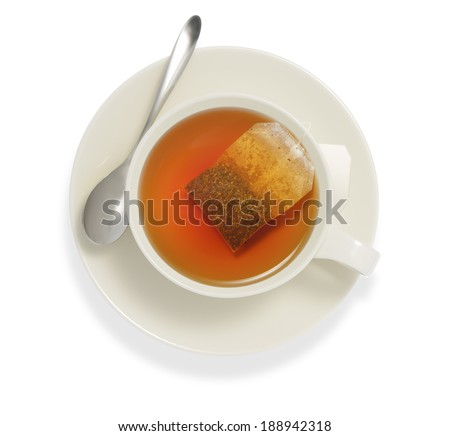 Top view of a cup of tea with tea bag, isolate on white - stock photo