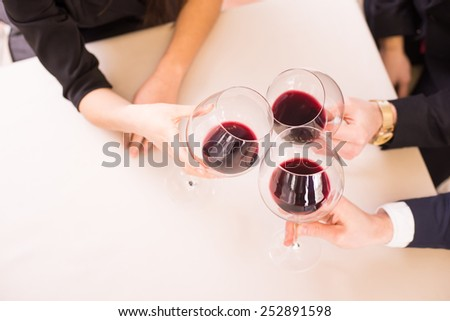 Top view of a glasses of wine. Business meeting. - stock photo