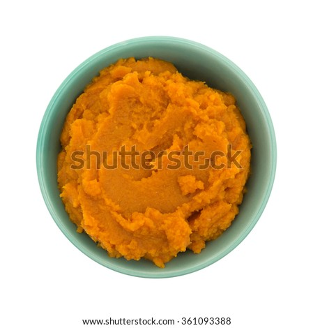 Top view of a green bowl filled with pumpkin pie filling isolated on a white background. - stock photo