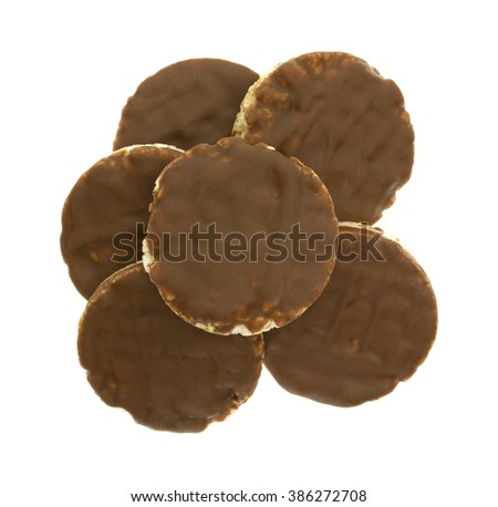 Top view of a group of organic rice cookies with milk chocolate icing isolated on a white background. - stock photo