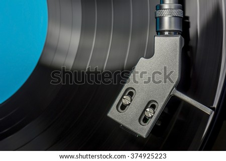 top view of a headshell from a record player while playing record, close up