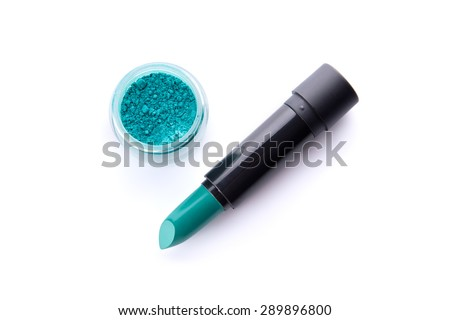 Top view of a lipstick and eye shadow in jar in bright teal green color, isolated on white background  - stock photo