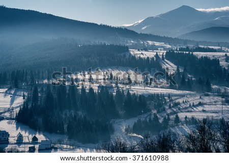 top view of a mountain village. natural winter background. vintage toned picture