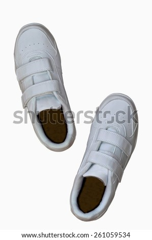 Top view of a pair of white sneakers isolated over white - stock photo