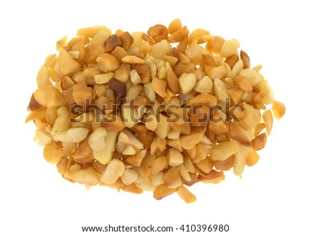 Top view of a portion of roasted and salted macadamia nut pieces isolated on a white background. - stock photo
