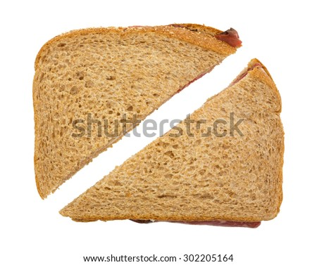 Top view of a roast beef sandwich that has been sliced in half isolated on a white background.