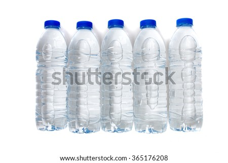 Top view of a row of plastic water bottles isolated on a white background.