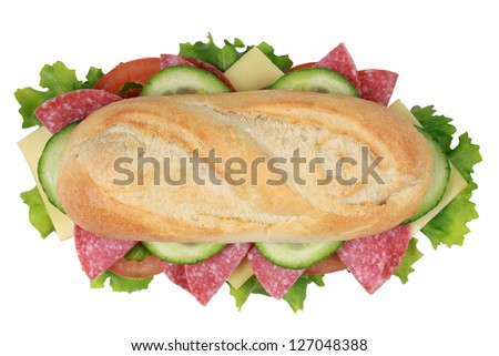 Top view of a sandwich with pepperoni, cheese, tomatoes, lettuce and cucumber - stock photo
