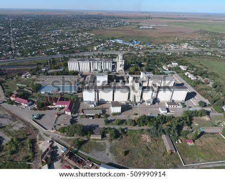 Top view of a silo elevator. The huge building for storing and drying grain. Aerophotographing industrial object.