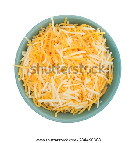 Top view of a small bowl filled with shredded white cheddar, sharp cheddar and mild cheddar cheeses isolated on a white background. - stock photo
