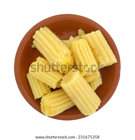 Top view of a small bowl of corn nuggets on a white background. - stock photo
