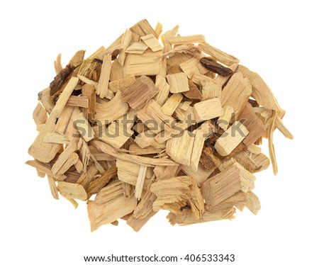 Top view of a small pile of hickory wood smoking chips for flavoring barbecue and grilled foods isolated on a white background.