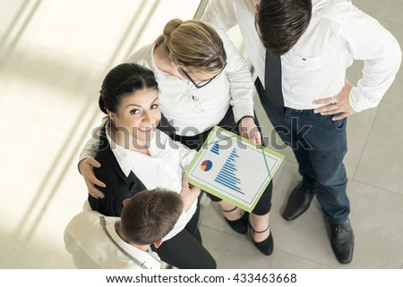 Top view of a successful business team analyzing finance reports - stock photo