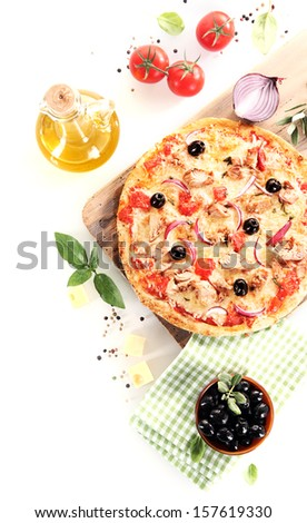 Top view of a tuna, olives, onion and basil pizza over a wooden board surrounded by the ingredients - stock photo