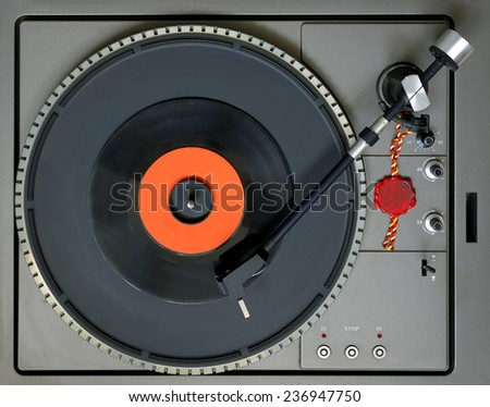 Top view of a turntable with level bubble and a 45 RPM vinyl - stock photo