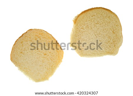 Top view of a white bread sesame seed hamburger bun open isolated on a white background.