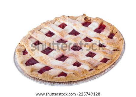 top view of a whole homemade lattice pastry crust cherry pie. This delicious thanksgiving and Christmas favorite dessert is isolated on a white background.