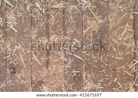 Top View of Aged, Rough texture Rustic dull Brown Cedar Wood Boards with hay scattered for Backgrounds with Blank Room or Space for your Design, Words, Text or Copy.  Horizontal warm tones