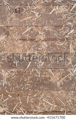 Top View of Aged, Rough texture Rustic dull Brown Cedar Wood Boards with hay scattered for Backgrounds and Templates with Blank Room or Space for your Design, Words, Text or Copy. Vertical warm tone - stock photo