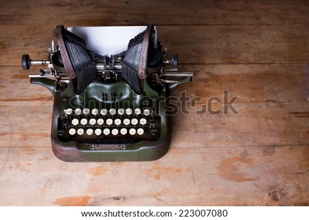 Top view of an old typewriter on a wooden table - stock photo