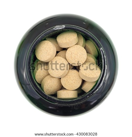 Top view of an opened bottle of brewer's yeast nutritional supplement isolated on a white background. - stock photo