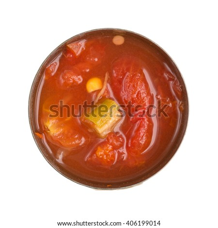 Top view of an opened can of corn, okra and stewed tomatoes in water with seasonings isolated on a white background.