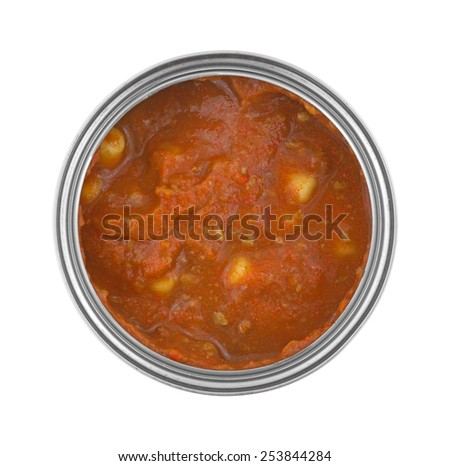 Top view of an opened can of food based in tomato sauce with ground beef and pasta. - stock photo