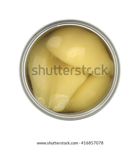 Top view of an opened can of pear halves isolated on a white background.