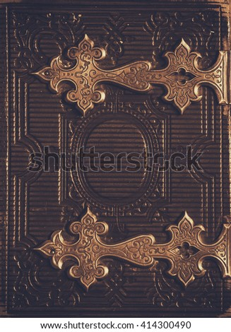 top view of antique book cover, with brass clasps. sepia vintage filtered