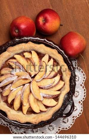 Top view of apple pie and apples - stock photo