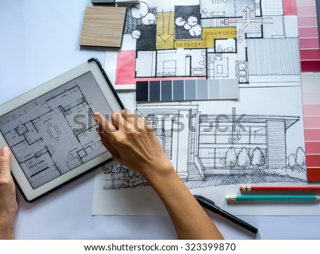Top view of Architects & Interior designers hands working on table with tablet and illustration/ home renovation concept - stock photo