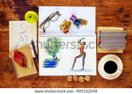 Top view of artist workspace with artistic work. - stock photo