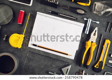 Top View of Assorted Do It Yourself DIY Tools and Blank Page Notebook as Copy Space for Home Improvement Project Planning or any Other Workshop Message. - stock photo