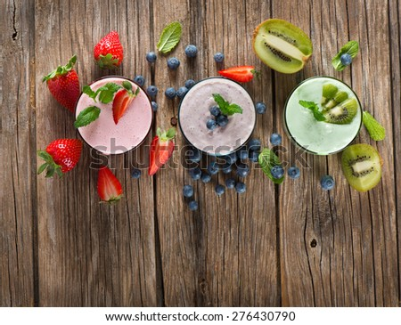 Top view of assorted smoothies of berry on a rustic wooden background - stock photo