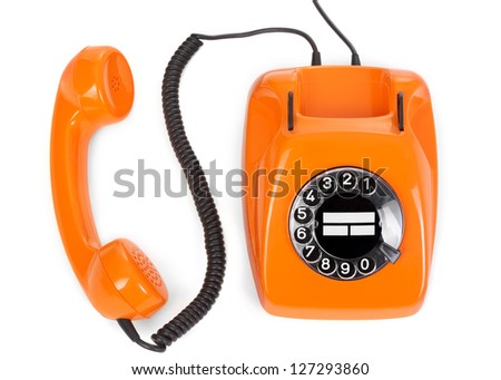 top view of bakelite rotary phone on white background - stock photo