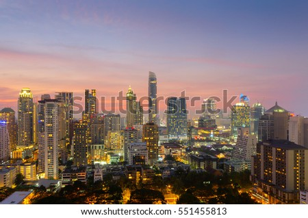 Top view of Bangkok modern office buildings, condominium in Bangkok city downtown with sunset sky ,Bangkok is the most populated city in Southeast Asia , Thailand.