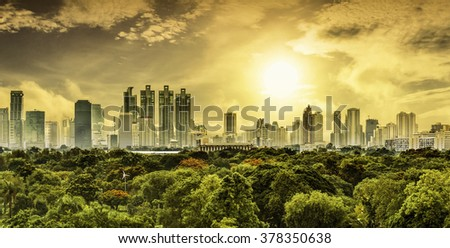 Top view of Bangkok Thailand behind the garden with sun in warm tone - stock photo