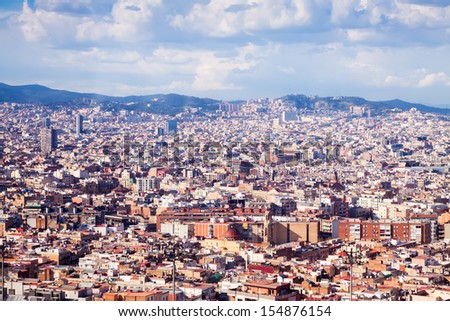 Top  view of Barcelona from high point in cloudy day. Spain - stock photo